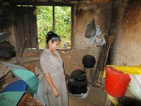 Sujatha with cooking utensils after loan from WDC
